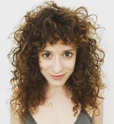 Curly Layered Hairstyle With Bangs