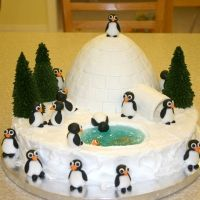 The penguins, fish and igloo tiles are fondant. Trees are sugar cones. Water is piping gel with blue food coloring. The igloo is the Wilton barbie doll cake pan (the dress). The cake was very time consuming but did not take much skill at all. Unique Cakes, Creative Cakes, Creative Food, Igloo Cake, Penguin Cakes, Owl Cakes, Penguin Party, Sugar Cones, Blue Food Coloring