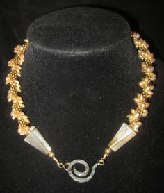 """""""Gold on Gold"""" Kumihimo Beaded necklace with gold magatama beads and spiral connector."""