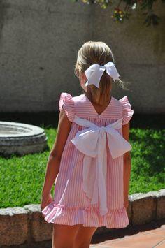 Vestido en rayas rosas con lazada blanca en www.donbabero.com