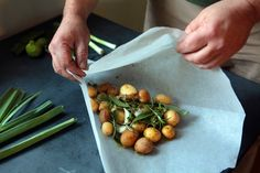 For an herb-infused delight, try cooking new potatoes in parchment, easier than it sounds. You pile a couple of pounds of potatoes onto a large round of baking parchment along with garlic, herbs and olive oil. Fold the parchment into a parcel and consign it to the oven for 45 minutes. When you open the package, steam-roasted new potatoes beckon. Indulge. (Photo: Jim Wilson/The New York Times)