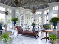 In a sun-drenched room on Long Island by Alexandra Loew, custom toile upholstery on the bergère and dining chairs pay tribute to the client's Dutch and Belgian heritage. See more indoor-outdoor design on Photo by Brandon Schulman Photography. Decor, Shingle Style Homes, Home, Residential Interior, Interior, Outdoor Rooms, House, Indoor, Outdoor Design