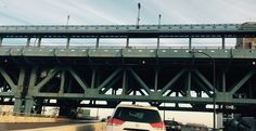Side view of the Ben Franklin Bridge from the on ramp to 676West (Vine Street Expressway) from 95 North in Philadelphia.