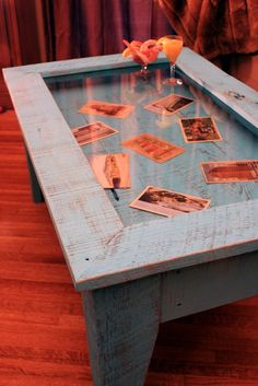 coffee table with hinged top.  love this idea.  it reminds me of the table at my memaw's house with all the pictures under glass.