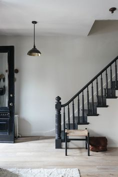 This particular craftsman staircase is truly a noteworthy design principle. Black Stair Railing, Black Staircase, Staircase Remodel, Staircase Railings, Staircase Design, Stairways, Staircase Diy, Staircase Runner, Entryway Stairs