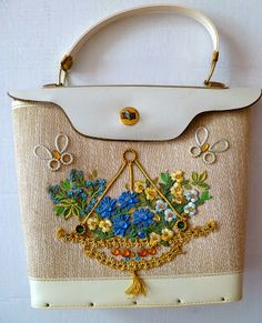 1960s kit purse with hanging flower basket and butterflies.
