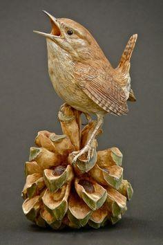Houtsnijwerk Vogel op sparappel