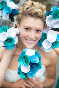 Anna Vaughan makes these paper rose wedding bouquets in Eureka! via Etsy.