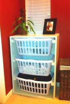 So love this idea...easy to build...much more durable than the plastic organizers you can get at the store adn the laundry baskets will be so much easier to be able to pull out...and if you use them as hamper/clothes sorters, you don't have to do anything else, just take the basket out and carry it to the laundry room :)