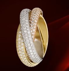 Cartier Trinity rings. I want them. M, are you seeing this?   :~D