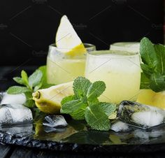 limoncello,Iralian traditional liqueur with lemons on the vintage table. Food & Drink Photos