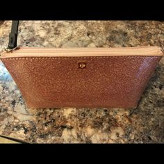NWT Kate Spade rose gold glitter make up bag NWT Kate Spade rose gold glitter make up bag  - perfect condition never used. 7 inches across 3 inches in diameter at bottom (narrows towards top) and is 3 1/2 inches high kate spade Accessories