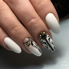 Black and White Studded Nail Art Design. Nothing is more beautiful than a combination of black and white with a spark of gold glitter and studs.