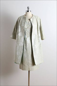 ➳ vintage 1950s dress  * pale shimmery sage green brocade * large embossed rose print * acetate lining * rhinestone & pearl bead accents * back zipper * matching jacket * button front * by Lilli Diamond  condition | excellent - original zipper has been replaced  fits like medium  dress length 40 bodice length 16 bust 38 waist 29 hips 40 coat length 35 shoulders 18 sleeves 15  ➳ shop http://www.etsy.com/shop/millstreetvintage?ref=si_shop  ➳ shop policies http:&#x2...