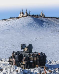 Protesters face off with police and the National Guard near Cannon Ball, North Dakota, February 1, 2017.  Photo credit: Ryan Vizzions
