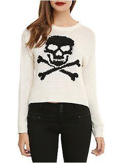 <ul><li>Cream knit sweater with black knit skull & crossbones design on front</li><li>100% acrylic</li><li>Wash cold; dry flat</li><li>Imported</li><li>Listed in junior sizes</li></ul>
