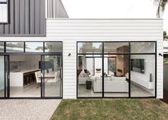 Drawing on the owner's curated inspiration, Sandy Anghie Architect has created a thoughtful modern extension… Contemporary Architecture, Architecture Design, Minimalist Architecture, Landscape Architecture, Grey Window Frames, Door Frames, Exterior Cladding, Facade House, House Cladding