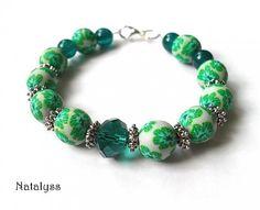 Náramok z ručne robených polymérových korálok - http://www.sperkysan.sk/sperkysan/eshop/2-1-Naramky/44-2-Zapinacie/5/1562-Zeleny-kvietkovany Bracelet with handmade polymer clay beads.