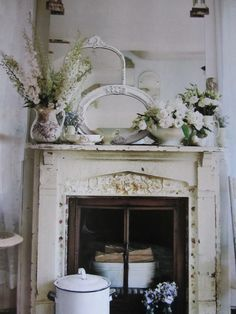 i like the broken crockery plastered around the fireplace.  there's something about white on white that is so clean.  it allows that hint of color to calm the soul.