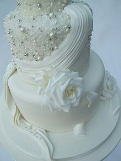 White-on-white with florals and pearls wedding cake.