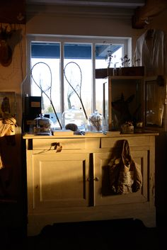 a lovely antique cupboard dressed with unusual gifts and bits and bobs