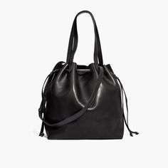 What goes into the new drawstring version of our Medium Transport Tote? Here it is by the numbers: 2 pieces of fine leather are used for the body. 2 ways to carry: with the top handles or the detachable shoulder strap. 2 for 1: cinch it closed to transform it into a bucket bag. 1 interior side zip pocket to keep your keys, phone and wallet at the ready. 24: the number of hours in a day that this style looks cool. How often you'll reach for it? 500 gazillion times. <ul><li>Made...