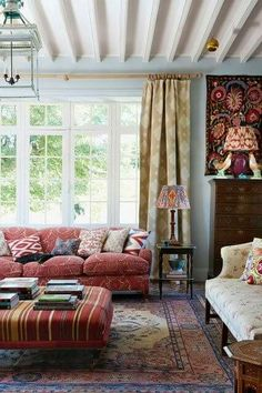 I'm not into the floral patterns on the sofa and chair, but I like the curtains, ottoman, and rug.