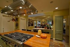 Island Stoves and Ovens | modern kitchen comes with a center island and an expansivegas range ...