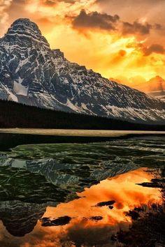 Light breaks through the cloud cover over Mount Chephren - Waterfowl Lake, Banff National Park, #Canada (© Jeff R. Clow)