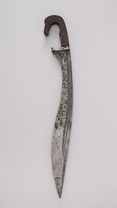 Knife (Falcata) Date: possibly century Culture: Iberian Medium: Steel, wood Dimensions: H. of blade 17 in. g) Classification: Knives