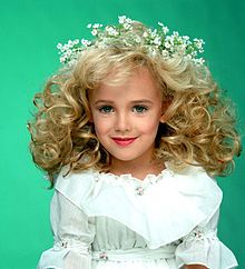 JonBenét Ramsey August 6, 1990 – December 25, 1996) was an American child beauty pageant queen who was murdered in her home in Boulder, Colorado, in 1996. The six-year-old's body was found in the basement of the family home nearly eight hours after she was reported missing. She had been struck on the head and strangled. The case, which after several grand jury hearings remains unsolved, continues to generate public and media interest