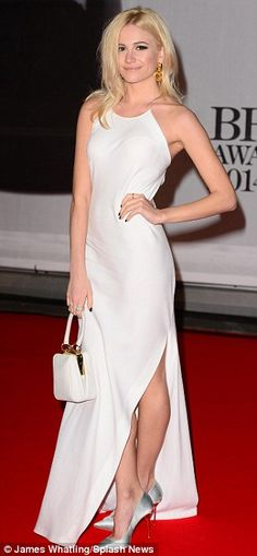 Slinky: Pixie Lott shows off some leg and her toned back in a floor-length white gown