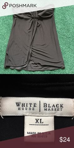 "White House Black Market strapless Black top . SEXY Top or tunic with very cute design. Has a lot of stretch and it's flattering with leggings, jeans or dress it up with the skirt. Length is 25"" NWOT- Never worn!! White House Black Market Tops Tunics"