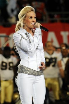 Pin for Later: See the Star-Studded Super Bowls From Years Past!  Carrie Underwood showed off her singing skills with the national anthem in Miami in 2010.