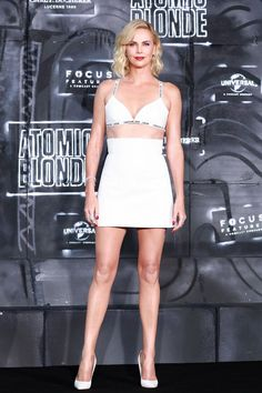 Charlize Theron wore Dior and Messika jewellery.