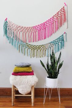 Colorful macrame bunting. Overall, I'm not wild about the resurgence of macrame, but the colors and shape of this one make it look fresh & fun rather than a throwback to the '70's.