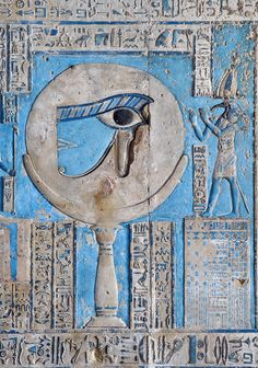 "[EGYPT 29568]  'The waxing moon and the Eye of Horus at Dendera.'    	This forceful image of the moon on a pillar, decorated with the ""healed eye"" of Horus, can be found on the astronomical ceiling of the outer hypostyle hall in the Hathor Temple at Dendera.  The astronomical ceiling consists of seven separate strips but here we are looking at a detail of the FIRST STRIP WEST from centre."