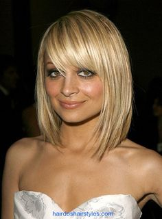 Cute Cut & full-bangs, I'm a fan of the hair; not the person, just to be clear :)
