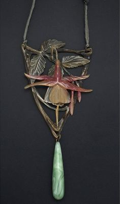 FRENCH ART NOUVEAU NECKLACE BY MME BONTE. Carved and stained horn with green agate glass drop and beads on silk cord, ca. 1900.