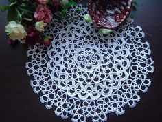 "Vintage Handmade Bobbin Lace White Round Doily/placemat by Victoria's Deco. $9.99. 100% cotton. Size:10"" round. Hand made. color: white. Very pretty and nice handmade  tatted lace doliy. Fine and high quality cotton yarn.   It measures 10""  round in white color  . Will look great as an elegant runner for table.  Because it was all handmade, the handcraft person should take a week to finish it. It is a great collection for your house.. Save 23% Off!"