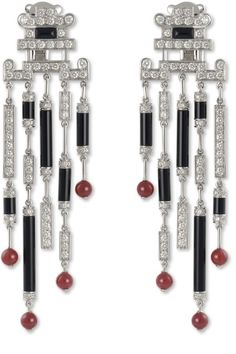 Coral, onyx, diamond and platinum earrings, by Cartier.