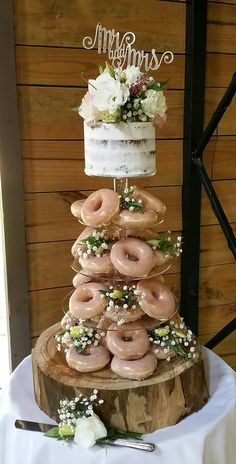 Wedding cake - Semi naked chocolate fudge cake and Krispy kreme donut. #chocolateweddingcakes - I like this idea with cookies instead of donuts underneath
