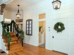 The+foyer+and+hallway+are+lit+with+pendant+lights+fashioned+in+the+style+of+antique+streetlamps.