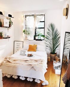 Weekend lounging in this perfect, mod Boho Bedroom. Neutral colors, greenery and tons of natural light! Love!