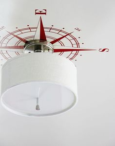 DIY Compass Ceiling Medallion--Easy way to add a little bling to a light fixture.