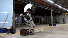 Handle is a research robot that stands 6.5 ft tall, travels at 9 mph and jumps 4 feet vertically. It uses electric power to operate both electric and hydr...