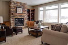 Bookcases and storage around a fireplace! Made by: Lakeside Cabinets and Woodworking
