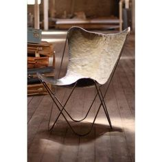 The Butterfly Chair is one of the most recognizable pieces of furniture design around. Originally created in 1938 by the Austral Group in Buenos Aires, Argentina, the chair was given the name BKF a… Classic Furniture, Unique Furniture, Industrial Furniture, Rustic Furniture, Furniture Decor, Furniture Design, Furniture Stores, Kitchen Furniture, Farmhouse Furniture