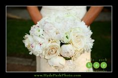 Gorgeous all white bouquet of roses and peonies, held by the bride on her wedding day at Austin Wedding Venue, Laguna Gloria Art Museum. Photo by Austin Wedding Photographers, Hyde Park Photography. http://www.HydeParkPhoto.com