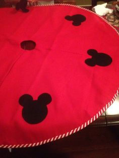 My moms homemade Disney Mickey Mouse tree skirt! Cheap felt tree skirt with black sticky felt pieces! Sure beats the $80 one we saw at the Disney store!!